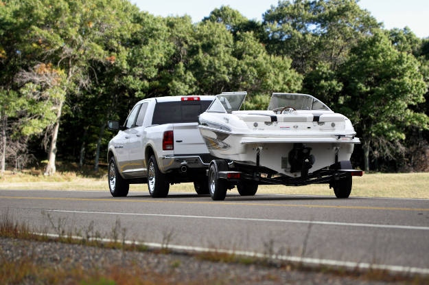 Pickup Truck Towing Boat Trailer