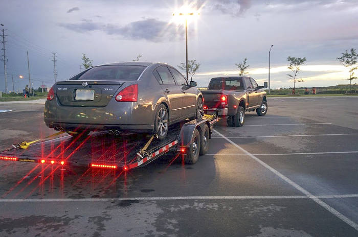 Pickup Truck Towing Car Trailer