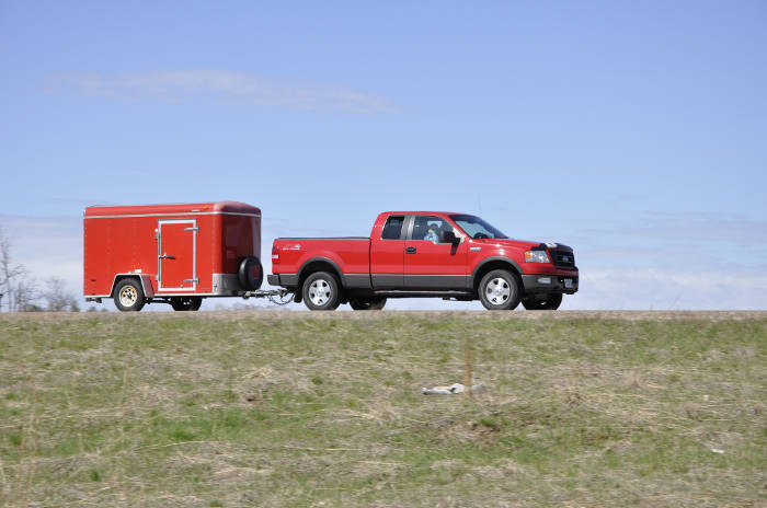 Pickup Truck Towing Small Enclosed Trailer
