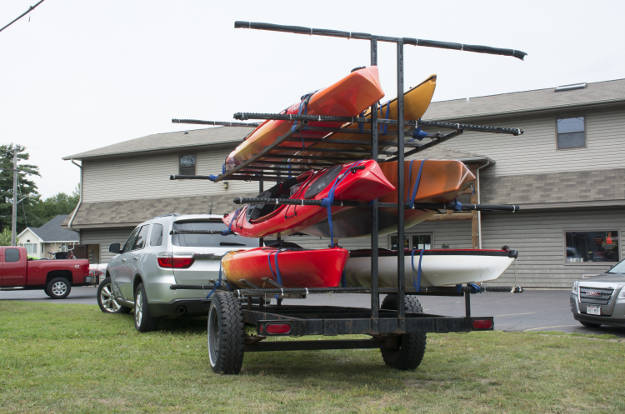 SUV Towing Kayak Trailer Parking Lot