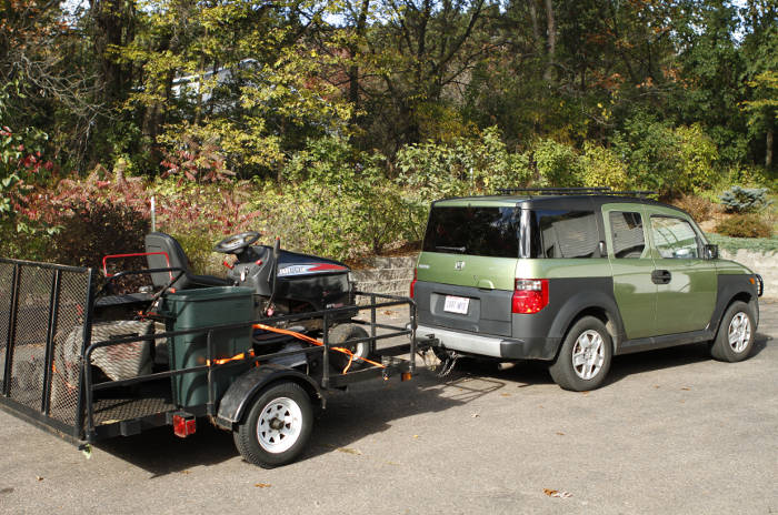 SUV Towing Small Landscape Utility Trailer