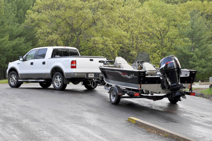 Truck Pulling Trailer with Fishing Boat