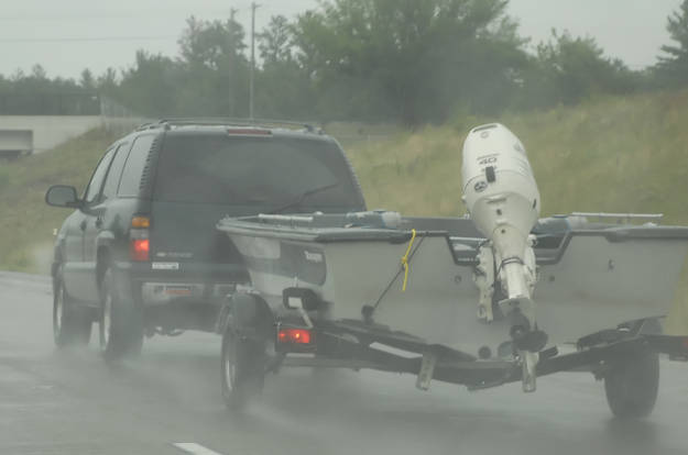 Truck Towing Boat Trailer Rain