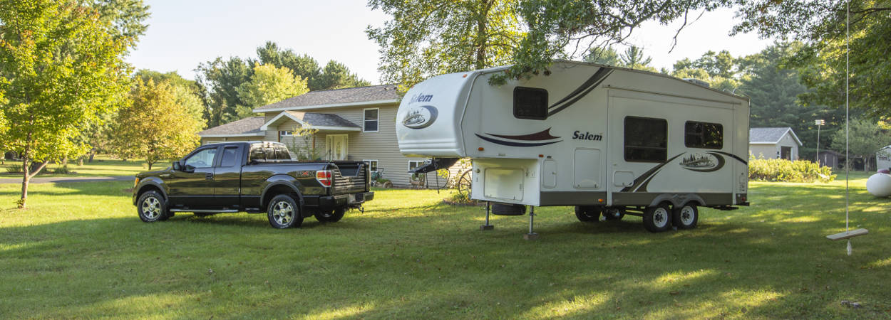 Unhitched 5th Wheel Trailer and Truck