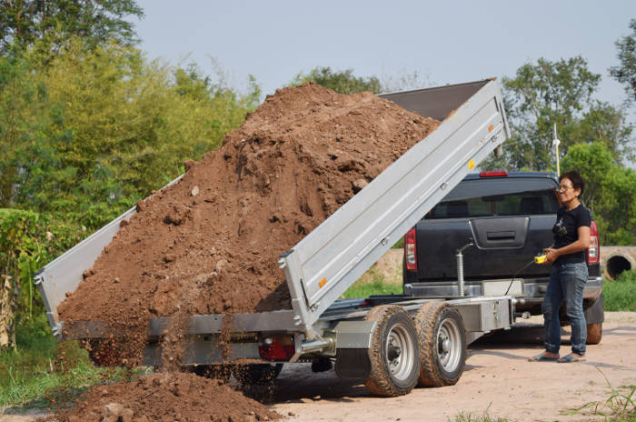Unloading Dump Trailer Full of Dirt