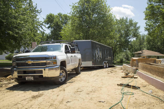 Work Truck Towing Enclosed Utility Trailer